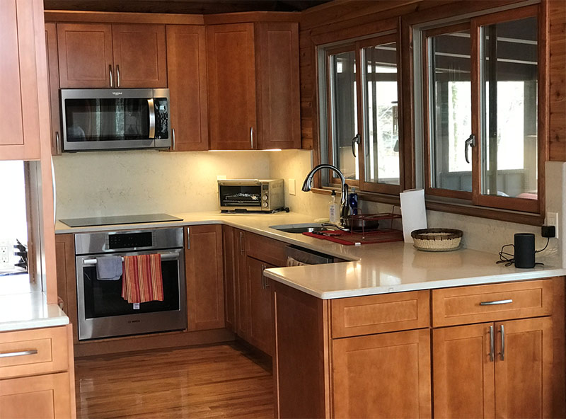 New kitchen with cherry wood and marble countertops