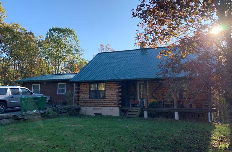 Log cabin on green grass