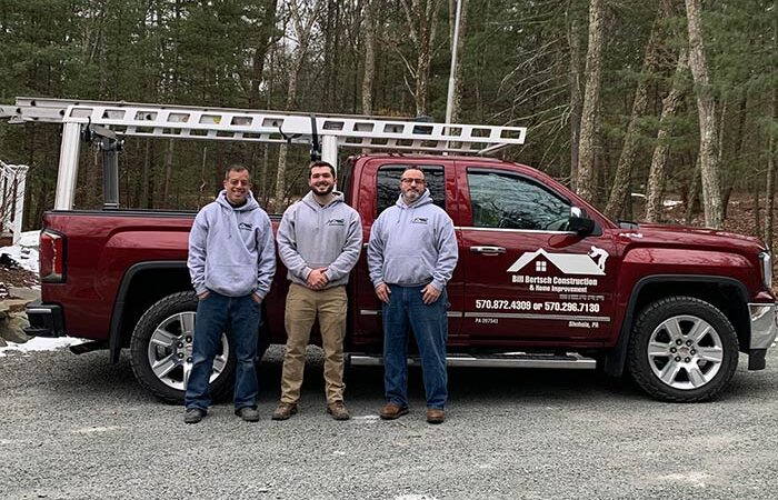 Crew standing in front of Bill Bertsch Construction truck