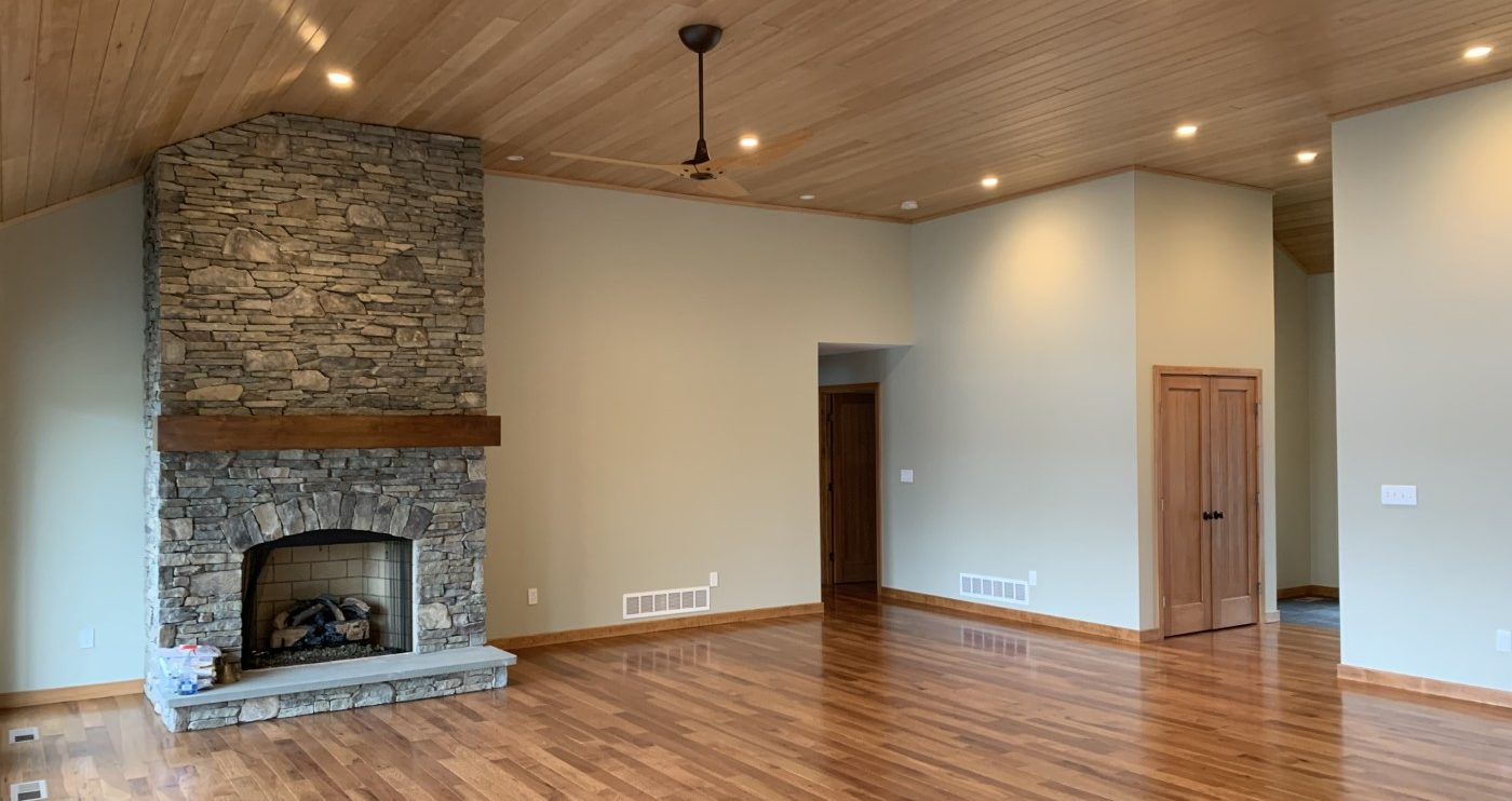 Beautiful living room with custom rock chimney